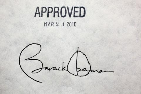 barack-obama-signature-on-aca